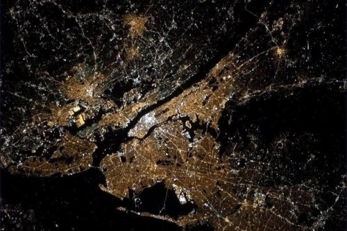 Absolutely stunning picture of New York City taken by Chris Hadfield from the International Space Station. Manhattan is white with activity. Incredible.