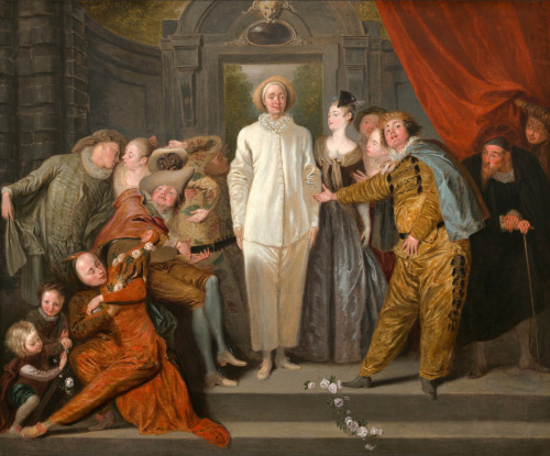a-l-ancien-regime:  Antoine Watteau (1684 - 1721)  The Italian Comedians, probably 1720 oil on canvas Antoine Watteau's The Italian Comedians presents fifteen figures arranged on stone steps and dressed in costumes typical of the commedia dell'arte theater. The Italian comedians were extremely popular performers whose fame rested on the audience's recognition of stock characters. Their plays were often greatly exaggerated by pantomime, gesture, and innuendo. Pierrot, dressed in shimmering white satin, stands in the center of the composition. Pierrot was a naive clown whose declarations of love were rejected by Flaminia, the heroine, placed to his left. Other well–known characters are Scaramouche, dressed in yellow and black, whose sweeping arm gesture presents Pierrot to the audience; on the left are Mezzetin, another clown who flirts with Sylvia, the ingénue, and Harlequin, the adventurer, shown with a black face in his red and green diamond–cut costume. The garland of flowers in the foreground steps suggests the actors are taking a bow after their performance; however the members united here were probably Watteau's own invention, and connected to a specific play or troupe. This tension between illusion and reality is typical of Watteau and influenced a generation of his followers to explore the relationships between painting and theater.