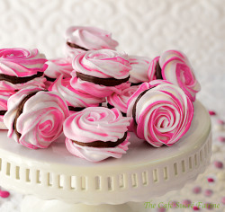 gastrogirl:  french meringues with strawberry ganache filling.
