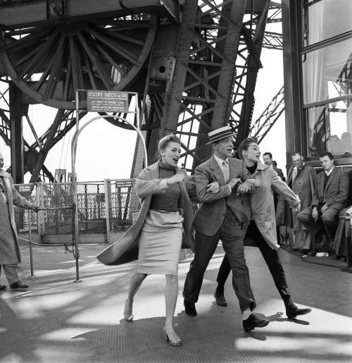"Kay Thompson, Fred Astaire, and Audrey Hepburn perform ""Bonjour, Paris!"" atop the Eiffel Tower for their film Funny Face, 1956."