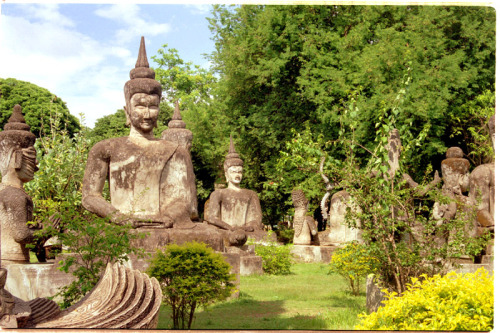 chrryblossomgirl:   Buddha Park, also known as Spirit City (Xieng Khuan), is a sculpture park located 25 km southeast of Vientiane, a small city that sits along the Mekong River in Laos. The park was started in 1958 by Luang Pu Bunleua Sulilat who was a priest-shaman. The park displays over 200 Buddhist and Hindu statues of deities, along with other beautifully carved strange figures.   I will go here one day