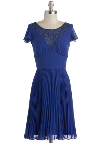 modcloth:  Blue, beaded, and roaring with 20s glamour. Shop the All That Pizzazz Dress.