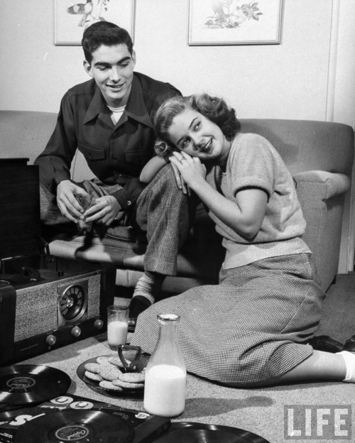 Ed Clark - Teenage couple listening to records and having a snack of milk and cookies. Atlanta, 1948.