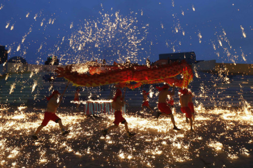 Kim Kyung-Hoon—Reuters  Feb. 10, 2013. Dancers perform a fire dragon dance in the shower of molten iron spewing firework-like sparks during a folk art performance to celebrate the traditional Chinese Spring Festival at an amusement park in Beijing. Read more: http://lightbox.time.com/2013/02/15/pictures-of-the-week-february-8-february-15/#ixzz2L73F41Q5