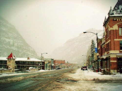 OURAY, COLORADO - SLUSHY SEASON or THE LONG, SLOW BREAK-UP  OURAY, 37 m. (7,800 alt., 707 pop.), seat of Ouray County, named for the great Ute chief, lies pocketed in a pear-shaped valley, with WHITE HOUSE MOUNTAIN (13,493 alt.) on the west, HAYDEN MOUNTAIN (13,100 alt.) on the south, and CASCADE MOUNTAIN (12,100 alt.) to the northwest. To the east, extending upward to the crest of the range, is a great natural amphitheater, part of the Ouray State Game Refuge. Densely wooded, but with many small parks, it is easily accessible on foot. Years ago the area was stocked with elk. Many are now so tame that they often wander along the streets of the town and through back yards, occasionally getting their antlers entangled in the family wash. — Colorado, A Guide To the Highest State (WPA, 1941)  Spring in the Rockies can be like a good relationship going through a long break up. At first the snow piles high and everything is transformed and clean white. It's all beautiful, new, exciting and fresh. Eventually the romance begins to fade, new fallen snow is more of a hassle to shovel and plow than a joy to see. Then it melts off, leaving things uglier, slushier, muddier than they were to begin with. Then it snows again, like a desperate one nighter, trying to reclaim a bit of winter's passion. But it quickly flees again, it wasn't meant to be and it leaves another dirty, slushy mess behind. And it will happen again, another quickie snowstorm before summer officially arrives — final break-up sex if you will. If you've ever lived through a Western winter and spring — or a really long and tedious break up — you know what I mean. *** KC O'Connor is a Guide to Wyoming for The American Guide. He's a writer and photographer based in Lander, Wyoming. Follow him on Tumblr and Twitter.