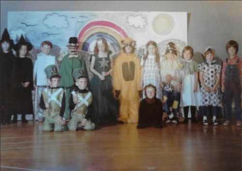 """This is a photo from 1977 when the 1st grade class of Miss Franceschetti and the kindergarten class of Mrs. MacNabb took on the challenge of the FULL Wizard of Oz script and musical production. This play was a huge undertaking for such a young group of children. And it goes to show what children can accomplish when inspired and connected with the right story. Recently the photo was shared on Facebook reconnecting the cast who shared their fond memories of being a part of the play over 35 years ago."" Submitted by Debbie (Coccia) Young, 42, Millersville, MD - Wicked Witch of the West (far left). The elementary school is located in Marcellus, NY. Have a great Oz photo? Click here to submit it to NPR's Backseat Book Club."