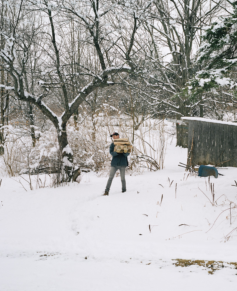 Alexi gathering wood, North Hatley, 2013