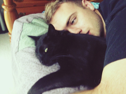 What's better than a sexy man cuddling a kitty? Not much.