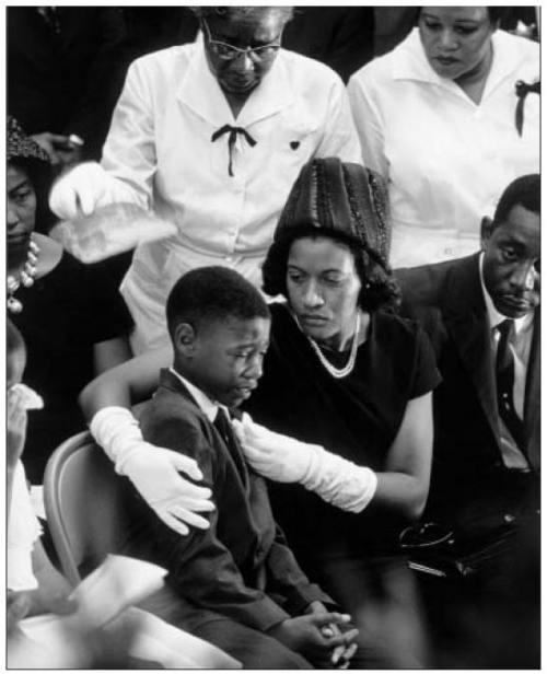 soulbrotherv2:  Medgar Evers' widow Myrlie Evers confronts their son Darrell at his 1963 Jackson, Mississippi funeral.