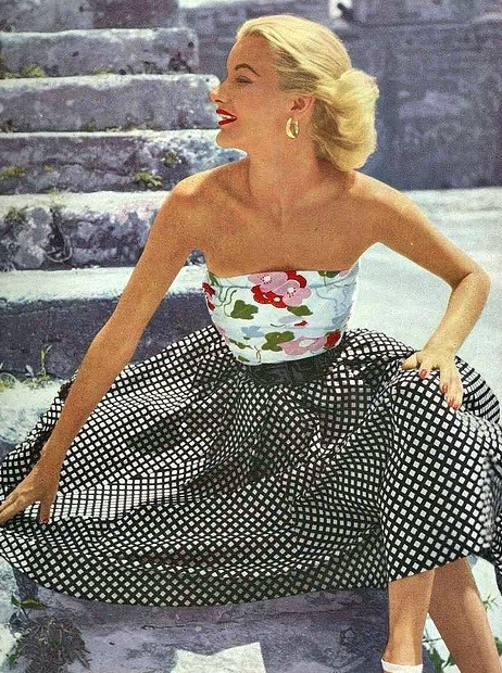 theniftyfifties:  Sunny Harnett wearing a strapless summer ensemble, 1951.