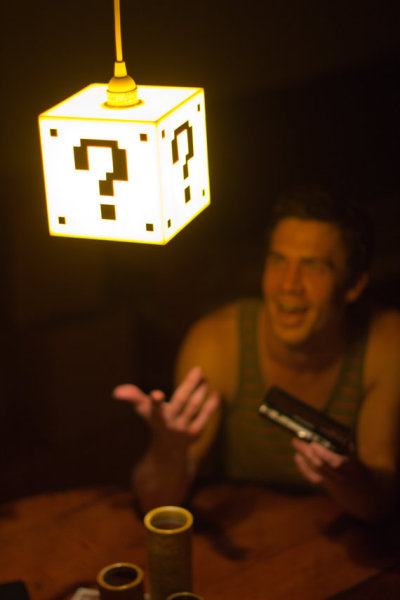 Gift Ideas for Geeky Ladies//Mario Lamp I said it before and I'll say it again, I love geeky home decor. I think this lamp can be subtle enough in a well decorated house to look really chique, without losing the touch with your inner geek. I always keep things like these as a future reference, 'cause I want my future home to look awesome! geekymerch:  (via Mario Question Mark Block Hanging lamp by TheBackPackShoppe)