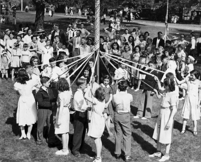 Oakland, CA May 1, 1937 - Children weave streamers around the May pole at the Oakland Zoological Gardens in part of the country celebration of May Day. (Oakland Tribune Staff Archives)