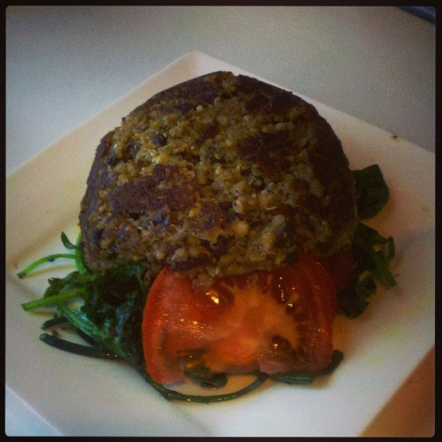 Haha looks like a turtle! Black bean, walnut, and quinoa patty on a bed of sauteed baby kale, with beefsteak tomatoes. It's super yummy <3