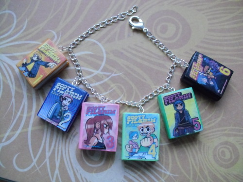 venom-orochi:  charmallama:  Scott Pilgrim book charm bracelet Can also be made into a keychain Available on my Etsy shop: https://www.etsy.com/shop/CharmaLlama  @cosmicvero yatusae  I would wear the crap out of this Scott Pilgrim bracelet.