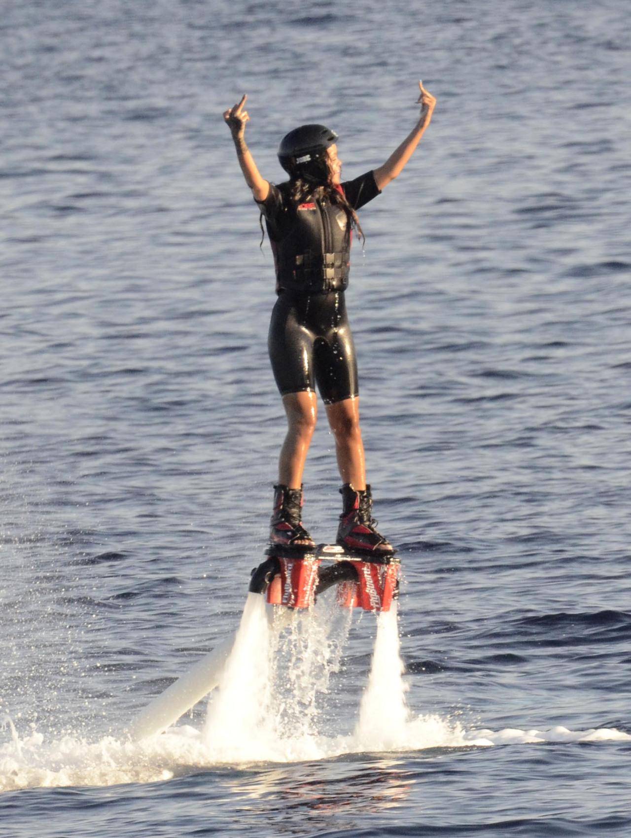 beccaoneal:  rihannainfinity:  August 30:Rihanna hydro jet surfing in Sardina, Italy  and then a herooooo comessss alooooong