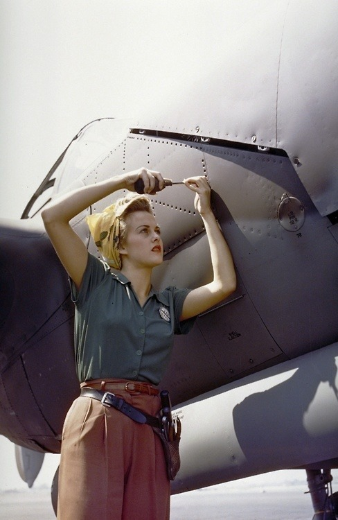 retrolovings:  A female Lockheed employee works on a P-38 Lighting in Burbank, CA - 1944.