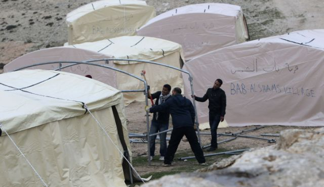 haaretz:   Dozens of Palestinians erected semi-permanent tents in the E-1 area of the West Bank on Friday in protest at continuing construction in the West Bank and East Jerusalem, and in attempt to create a foothold for what they hope will become a permanent settlement.