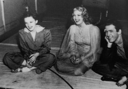 gummgarland:  Judy Garland, Lana Turner and Jimmy Stewart laughing c.1941