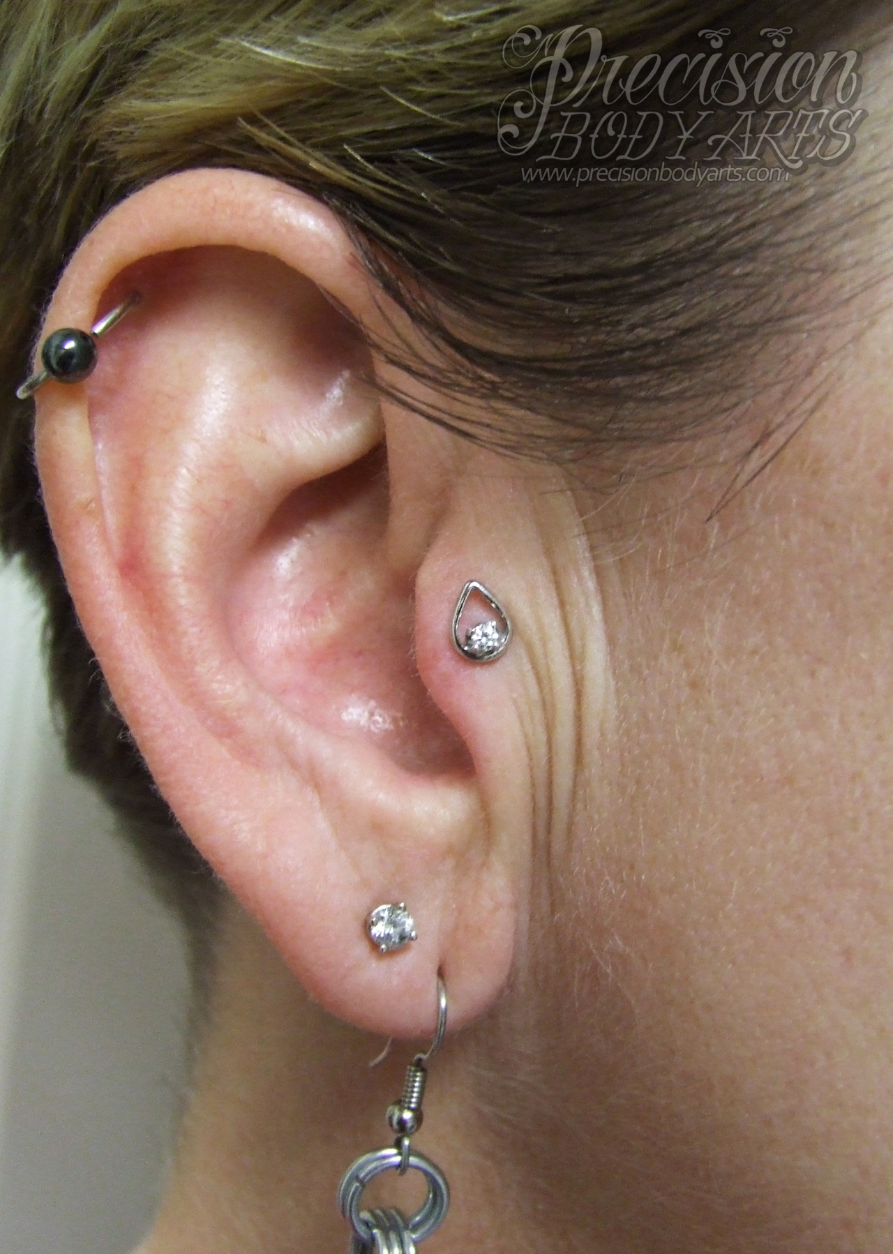 Tragus piercing by Ryan Ouellette. Precision Body Arts in Nashua, New Hampshire. Jewelry by Body Vision.
