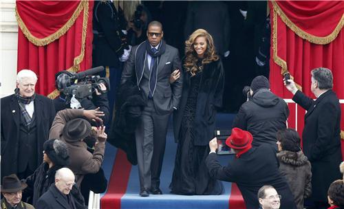 Recording artists Beyonce (R) and Jay-Z arrive ahead of the swearing-in ceremonies for U.S. President Barack Obama on the West Front of the U.S. Capitol in Washington, January 21, 2013. REUTERS/Jason Reed      I seemed to have misplaced my can.