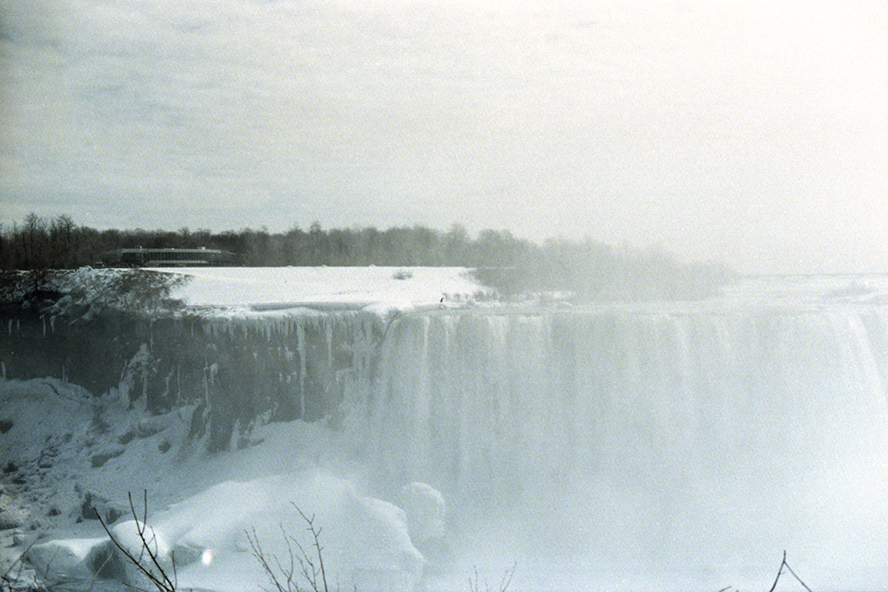 just got my negatives from a mini trip my family and i took to canada. it was so misty at the falls, but i love how it made the image look almost like a watercolor painting… soft, grainy texture with shades of each color represented. can you spot the black crow? :]