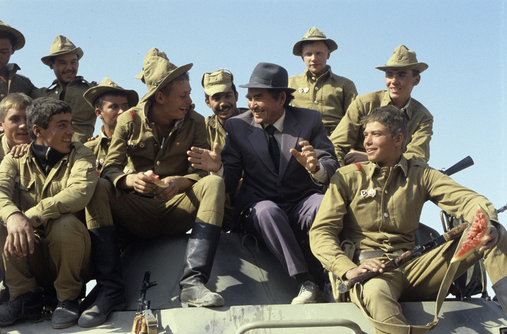 """historynet:  """"Soviet soldiers welcomed by a local resident upon their return from Afghanistan"""", 20th October 198"""