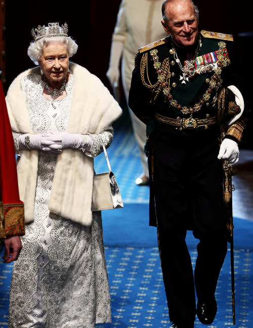 Queen Elizabeth II, and Prince Phillip, Duke of Edinburgh walk through the Norman Porch of the Palace of Westminster after the State Opening of Parliament on May 8, 2013 in London, England.