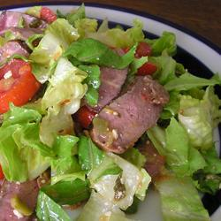 Steak Salad Recipe |  Steak Salad | Sirloin and a light vinaigrette top this crunchy, refreshing salad.
