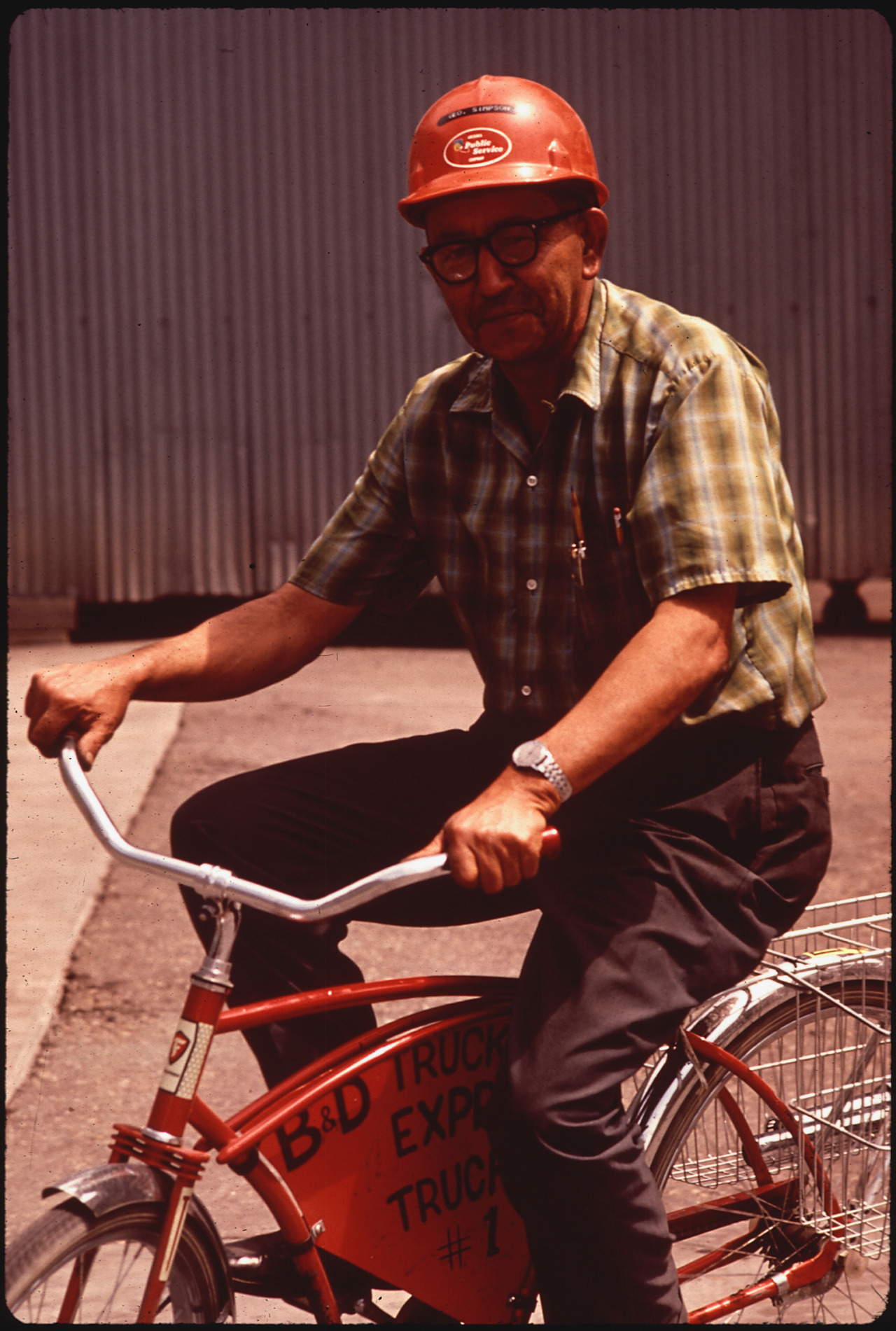 "It's bike to work day!  ARIZONA, 05/1972 Terry Eiler, photographer.  From the EPA's DOCUMERICA series.  (More items from DOCUMERICA are currently on exhibit at the National Archives:  ""Searching for the Seventies: The DOCUMERICA Photography Project"")  Unfortunately the caption doesn't tell us much, but we know this smart cyclist remembered his helmet! Did you bike to work?  Tandem? Recumbent? Bikeshare?"