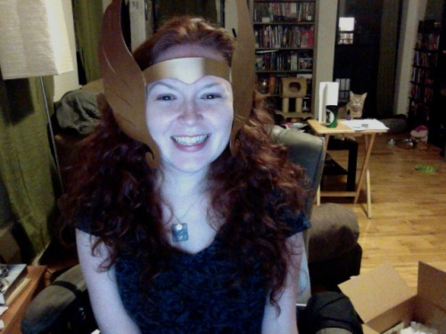 So, even though my head is abnormally large, the new She-Ra crown still doesn't want to stay on. These were the few pics I managed to take before it slipped off. Also, I broke into laughter in the middle when I realized Dewey was photobombing me. Anyway, it will make a nice display piece. :)