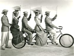 Betty Garrett, Frank Sinatra, Esther Williams and Gene Kelly ride a bike. Jules Munshin stands. Play ball!