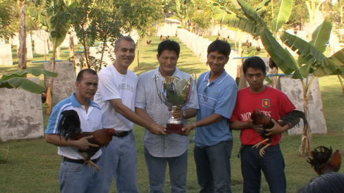 Hey, these men have won the championship for the best serious men holding birds awards 2001, and they have gone to a graveyard to celebrate. The three men in the middle do not have to be serious, because Happy Men Holding Trophies Awkwardly is another blog. The book-ending men are serious because they are holding birds. Serious.