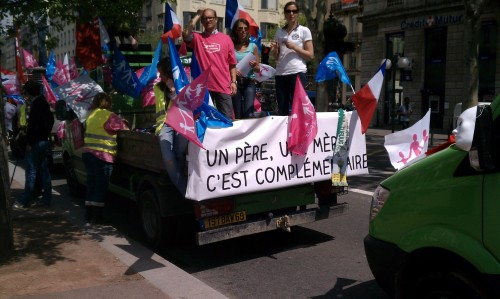 "There was an anti-marriage equality rally in Lyon today. Most of the protesters wore red, white, and blue and carried signs like this one (it translates to ""a father, a mother: it's complementary""). This truck kept blaring ""Gangnam Style"" but, sadly, nobody attempted the dance."