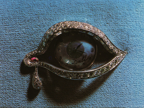"fragm3ntal:  Eye of Time brooch by Salvador Dalí. A clock can be discerned inside the eye. Speaking of this particular piece, created with diamonds, rubies and platinum, Dalí used to say: ""one cannot flee from time, nor change it. The eye sees the present and the future"".  ""In 1981 the collection was acquired by a Saudi multimillionaire, and later by three Japanese entities, the last of which agreed to sell it to the Gala-Salvador Dalí Foundation…"" More here."