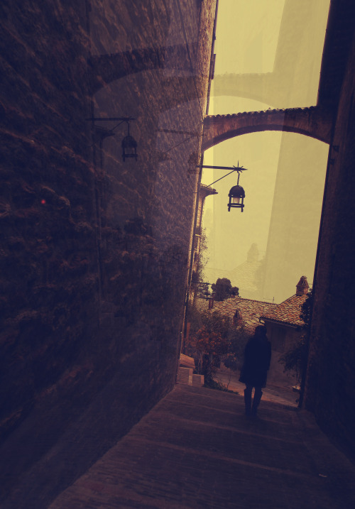 """Alleyways in Assisi."" .. I can still feel the cold air, the spinning unreal sensation of looking at the sky and the walls and every crack and corner.  I wish I could go back and lay on the stone ground .. repent, repeat. repent, repeat. repent, repeat."