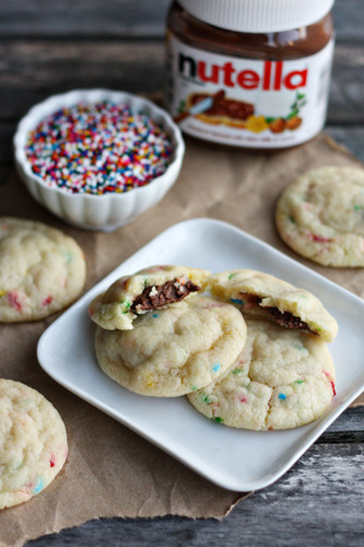 bakeddd:  5 ingredient nutella-stuffed funfetti cookies click here for recipe  yes please