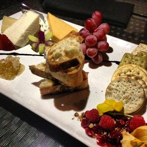 Cheese Platter #grapes #crackers #baguettes #strawberries #raspberries #honeycomb #goatcheese #othercheesesIforgotabout  (at Vines Grille & Wine Bar)
