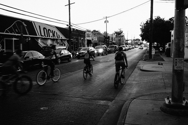 Bike Oak Cliff on Flickr.People on bikes leaving the Bishop Arts District and heading down Davis Street in Oak Cliff. Camera: Fujifilm X100