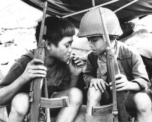 thiswastheirfinesthour:  Vietcong child soldiers share a cigarette, 1967