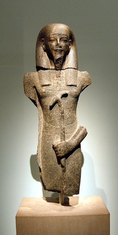 Granite statue of a male god New Kingdom, 18th dynasty, ca. 1390 - 1352 BC  The male god is holding a was-sceptre and has the clear facial features of the period of King Amenhotep III.  Egyptian.  Source: The Metropolitan Museum