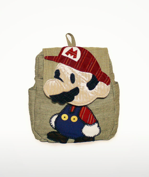 Paper Mario Backpack is Super Stylish Etsy user GeekyU1 created this embroidered Super Paper Mario backpack that's reeeeallll nice. I really dig Mario's swanky mustache and his hand nubs — that's a real nice and simple/cute touch there. The item's on sale for $85 on GeekyU1's shop if you need a new super cool backpack for school or other personal use. Check it: More Mario on AlbotasBuy it: Paper Mario: Sticker Star (3DS)