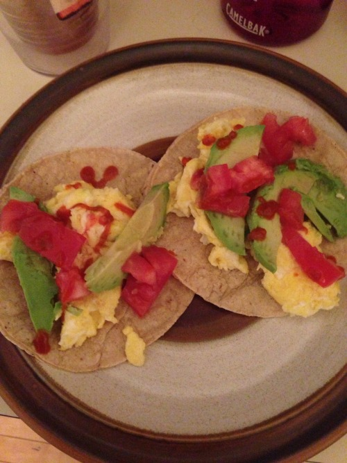 Sassy's bdb - scrambled eggs, corn tortillas, avocado, tomato, sriracha, coffee and water.