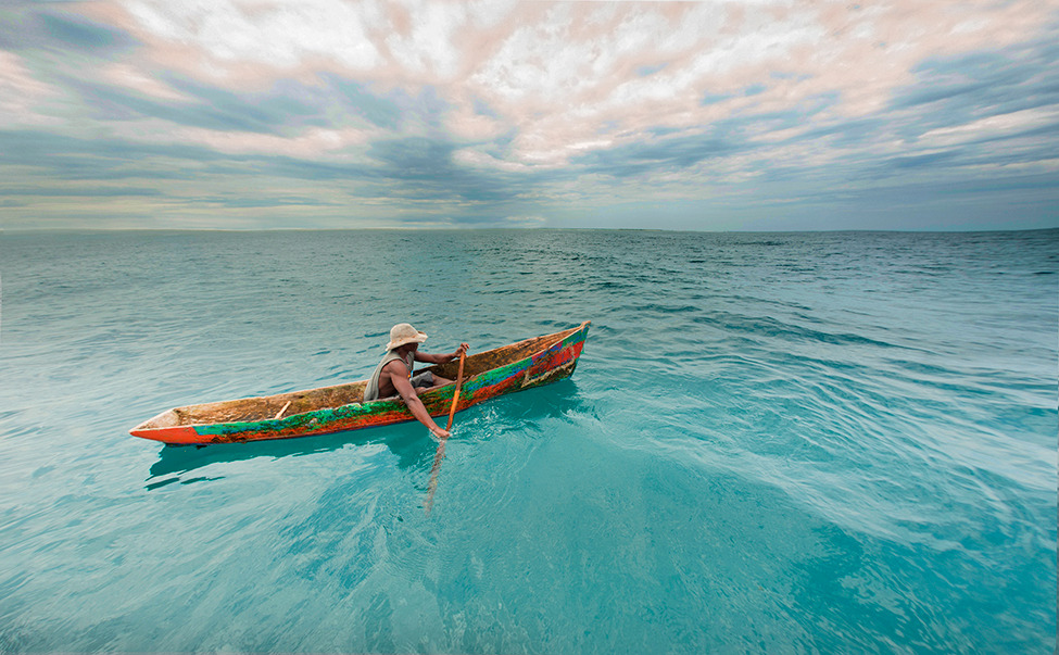 Photo of the Day: A man in a traditional boat in Mozambique Photo by: Dale Morris (South Africa); Mozambique
