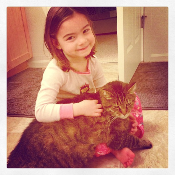 My niece and her cat, Fumble. #friendsforever #gentlegiant