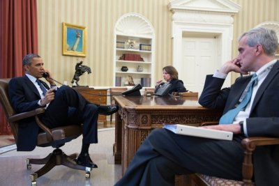 President Barack Obama on the phone with FBI Director Robert  Mueller to receive an update on the explosions that ripped through the crowd near the finish line of the Boston Marathon. [via The White House]
