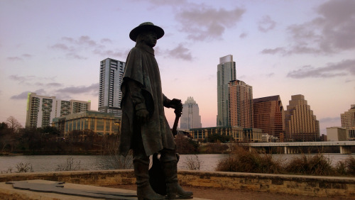 "STEVIE RAY VAUGHAN STATUE - AUSTIN, TEXAS  Many persons who have achieved fame have lived here…Elizbet Ney, sculptor, made the city her home. O. Henry (William Sidney Porter) at one time lived in Austin, where he published The Rolling Stone. Amelia E. Barr lived here in the 1850s and wrote many novels and poems of the sentimental type then in vogue. Her Remember the Alamo was read in nearly every Texas home. — Texas, A Guide To the Lone Star State (WPA, 1940)  Musician Stevie Ray Vaughan moved to Austin in 1971. Twenty years later, Texas governor Ann Richards proclaimed October 3rd, 1991 to be ""Stevie Ray Vaughan Day"" in the state. It is celebrated the first Sunday of each October. * * * Michael Marchio is a state guide to Texas."