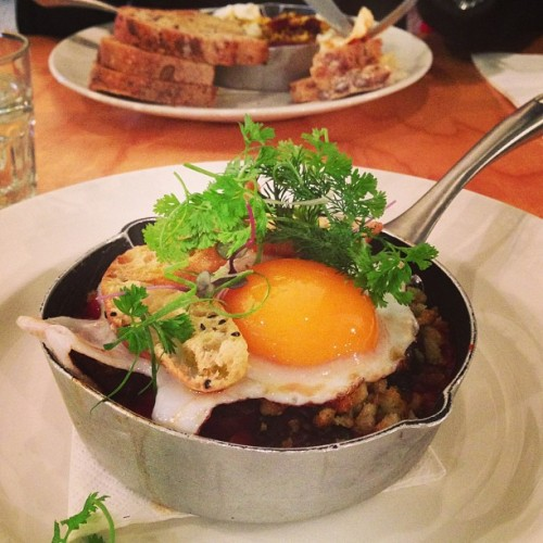 Pork belly & duck egg cassoulet. #breakfast #axil #melbourne #cafe #food #pork #egg  (at Axil Coffee Roasters)