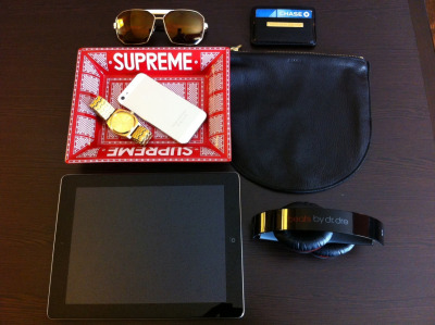 Travel essentials. Supreme catch all tray, iPhone, Nixon gold watch, Baggu travel pouch, Alexander McQueen wallet, iPad, Dre Beats Headphones, Marc Jacobs sunglasses. #swag #youngandcultured #tourlife