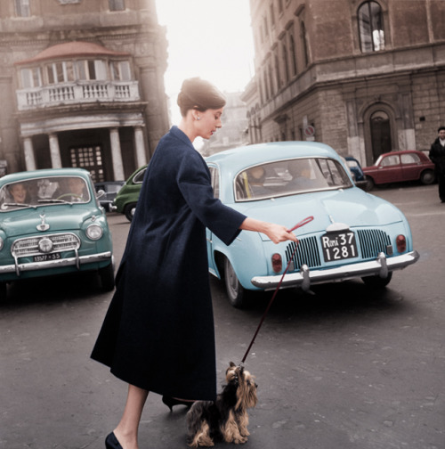 Audrey Hepburn and Mr. Famous leave the Hotel Hassler, on the Piazza Trinità dei Monti, 1960. (Notice how excited the couple in the car is to see Audrey crossing the street. -RAH)