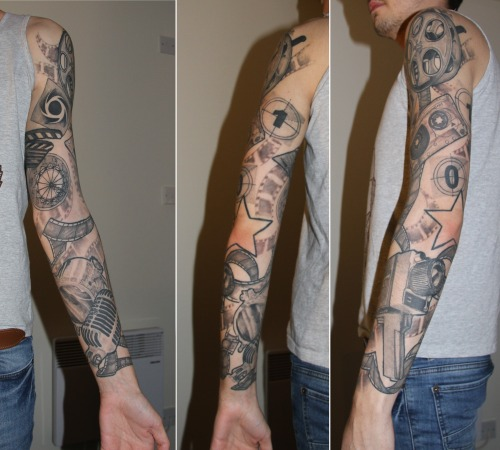 fuckyeahtattoos:  This is my film and media sleeve done by Stu at Hawkeye's Tattoo Carnival in Cleveleys, England. It was a rescue job after my first artist made a bit of a mess. Parts are still settling in and I may need a little more work, but I'm so happy with it. Media and film are my passions, and I'm studying Broadcast Journalism at University, so this is my tribute.